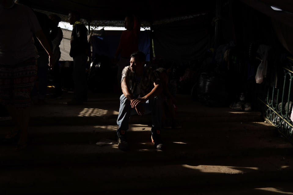 A man from Honduras sits at a makeshift camp for migrants Friday, May 14, 2021, in Reynosa, Mexico, just blocks from the U.S.-Mexico border. The man had been released to Mexico after trying to cross into the U.S., and said he now plans to return to Honduras. (AP Photo/Gregory Bull)