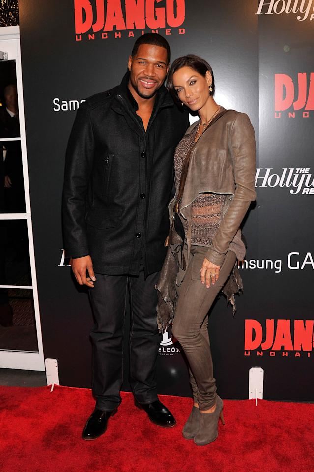 """NEW YORK, NY - DECEMBER 11:  Michael Strahan and Nicole Murphy attends a screening of """"Django Unchained"""" hosted by The Weinstein Company with The Hollywood Reporter, Samsung Galaxy and The Cinema Society at Ziegfeld Theater on December 11, 2012 in New York City.  (Photo by Stephen Lovekin/Getty Images)"""