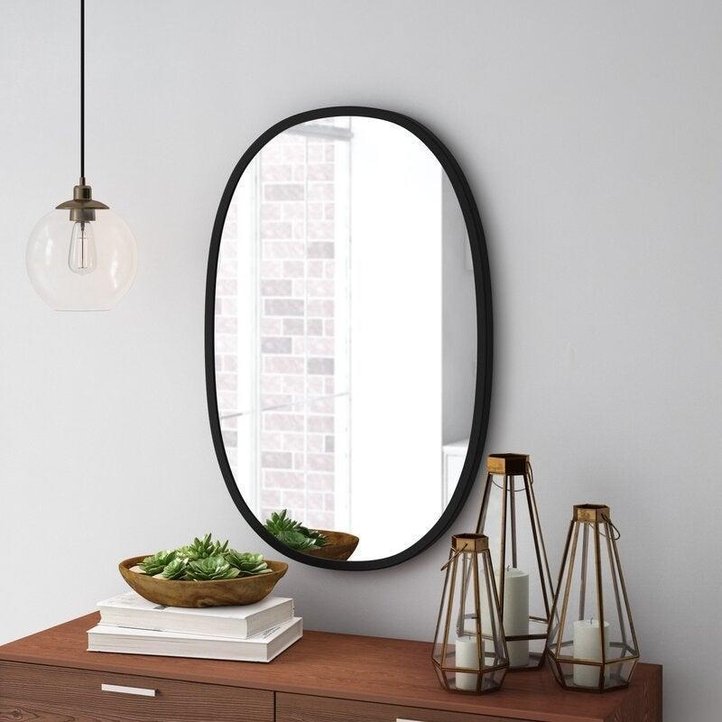 "<h2>Hub Modern and Contemporary Accent Mirror</h2><br><strong>Discount:</strong> 42% off<br><br><strong>The Hype: </strong>4.7 out of 5 stars and 748 reviews<br><br><strong>Deal Hunters Say: </strong>""This mirror is so beautiful. This came packaged VERY well. I don't think it would have broken going down a flight of stairs. Overall, I am very happy with this purchase.""<br><br><em>Shop </em><strong><em><a href=""https://fave.co/2IMTLj0"" rel=""nofollow noopener"" target=""_blank"" data-ylk=""slk:Umbra"" class=""link rapid-noclick-resp"">Umbra</a></em></strong><br><br><strong>Umbra</strong> Hub Modern and Contemporary Accent Mirror, $, available at <a href=""https://go.skimresources.com/?id=30283X879131&url=https%3A%2F%2Ffave.co%2F3kNYOgN"" rel=""nofollow noopener"" target=""_blank"" data-ylk=""slk:Wayfair"" class=""link rapid-noclick-resp"">Wayfair</a>"