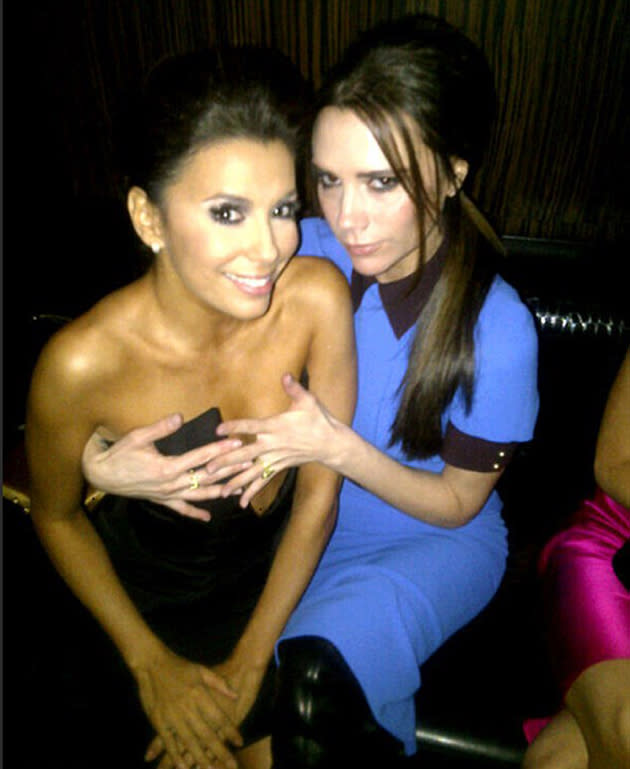 Celebrity photos: Victoria Beckham got up close and personal with BFF Eva Longoria during their girls' night out.
