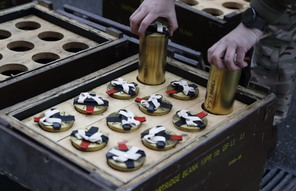 A soldier prepares blank shells to be used during a 41 gun salute in memory of Prince Philip at the Royal Artillery barracks in Woolwich, London, Saturday, April 10, 2021. Buckingham Palace officials announced Friday that Prince Philip, the husband of Queen Elizabeth II, has died . He was 99. (AP Photo/Alastair Grant, Pool)