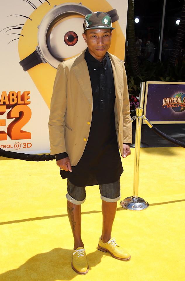 "UNIVERSAL CITY, CA - JUNE 22: Recording artist Pharrell Williams attends the premiere of Universal Pictures' ""Despicable Me 2"" at the Gibson Amphitheatre on June 22, 2013 in Universal City, California. (Photo by Frederick M. Brown/Getty Images)"