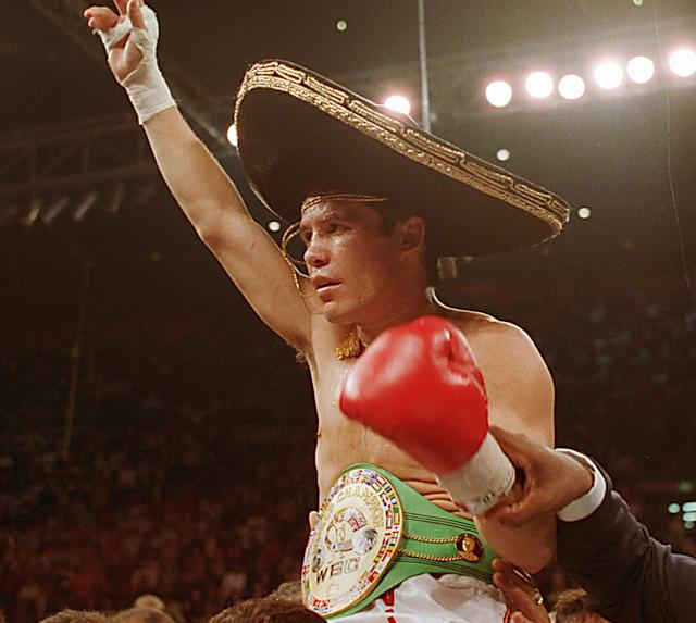 <p>From his first professional bout in February 1980 to September 1993, Chavez won all 87 of his fights. No losses, no draws in more than 13 years. The previous record official win streak in boxing was 62 by Willie Pep in the 1940s. Floyd Mayweather Jr.'s career 49-0 record is the best recent example of extended dominance, but Chavez's streak is highly unlikely to ever be topped simply because modern-day boxers don't fight nearly as often anymore. It took Mayweather 19 years to accumulate his 49 wins. </p>