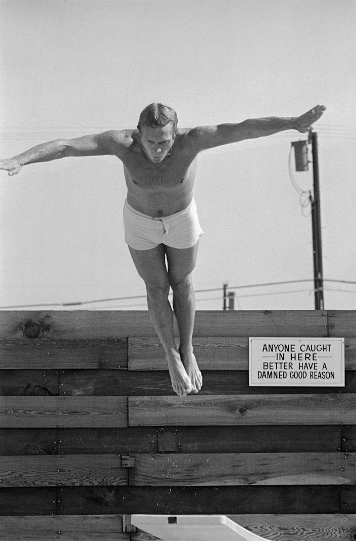 <p>Steve McQueen dives off of his diving board at his Palm Springs, California, home in 1963.</p>
