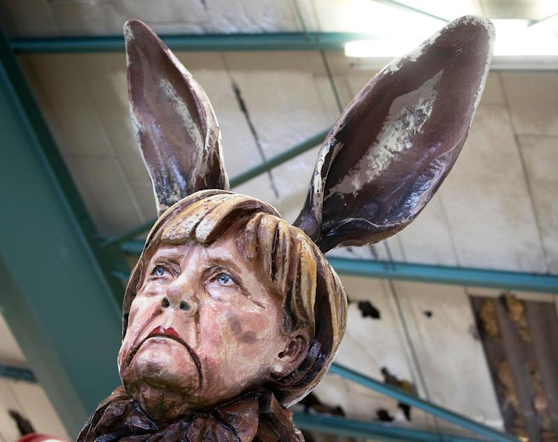 A figure depicting German Chancellor Angela Merkel is shown during a press preview in a hall of the Mainz carnival club in Mainz, Germany, Feb. 26, 2019. (Photo: Michael Probst/AP)