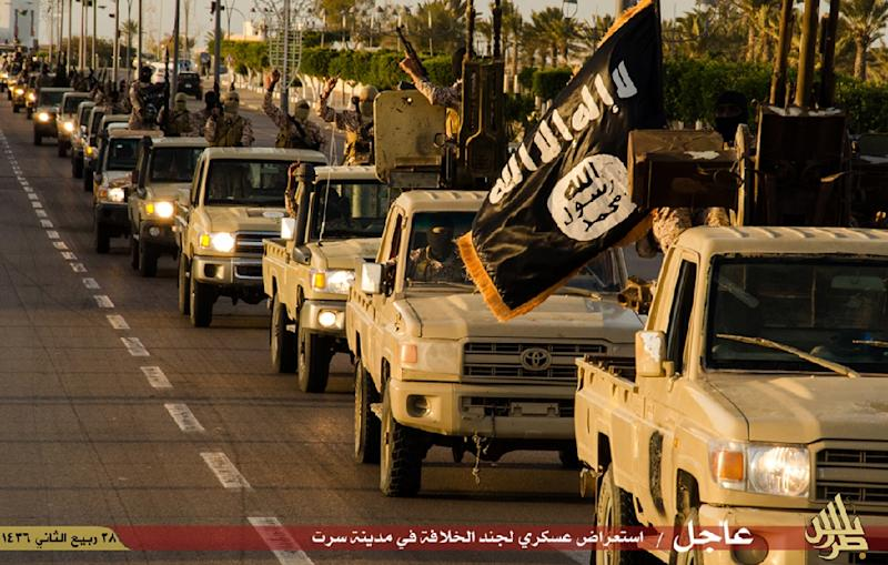An image made available by propaganda Islamist media outlet Welayat Tarablos on February 18, 2015, allegedly shows members of the Islamic State (IS) militant group parading in a street in Libya's coastal city of Sirte (AFP Photo/)