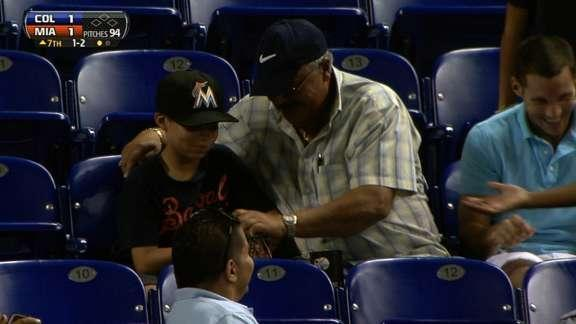 Young Marlins fan makes sweet no look catch of line drive foul ball