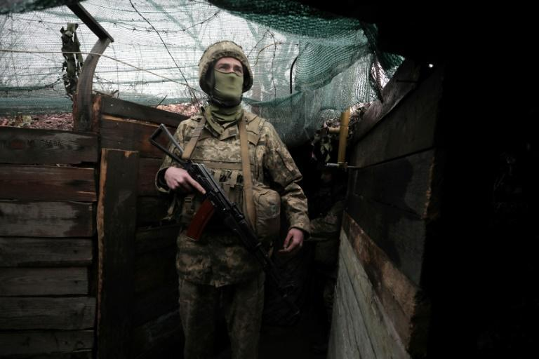 A Ukrainian serviceman stands on the frontline with Russian-backed seperatists in the Donetsk region