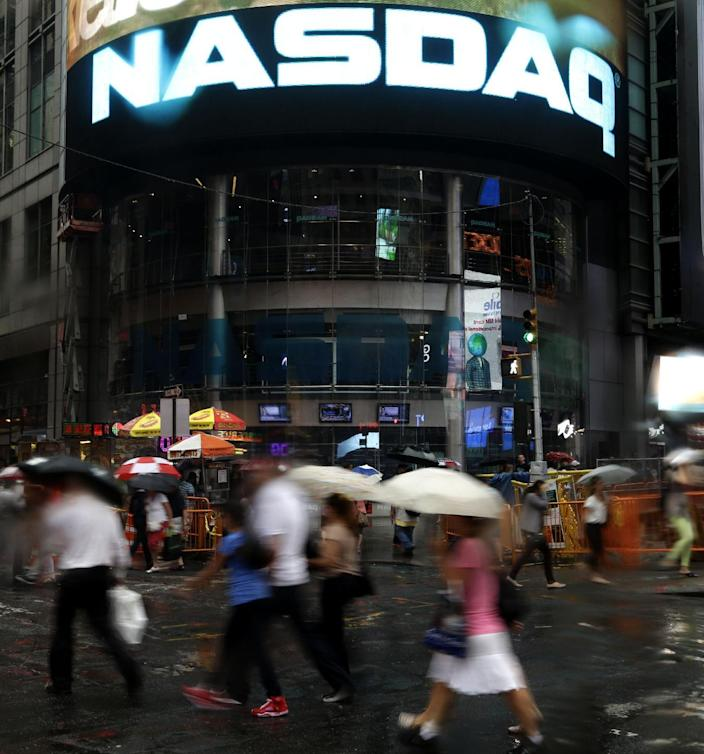 The Nasdaq logo is displayed on its building in New York, Thursday, Aug. 22, 2013. Nasdaq halted trading Thursday because of a technical problem, the latest glitch to affect the stock market. (AP Photo/Seth Wenig)