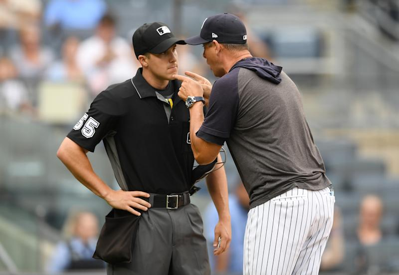 NEW YORK, NEW YORK - JULY 18: Manager Aaron Boone #17 of the New York Yankees argues with home plate umpire Brennan Miller #55 during the second inning of game one of a doubleheader against the Tampa Bay Rays at Yankee Stadium on July 18, 2019 in the Bronx borough of New York City. (Photo by Sarah Stier/Getty Images)