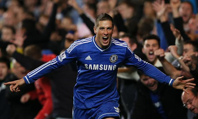 """FILE - In this Sunday, Oct. 27, 2013, file photo, Chelsea's Fernando Torres celebrates after scoring the winning goal during the English Premier League soccer match between Chelsea and Manchester City. Chelsea says it has agreed terms with AC Milan for striker Fernando Torres to join the Serie A club in a two-year loan deal. The Premier League club said in a statement that """"the move is now subject to Fernando agreeing personal terms with AC Milan and passing a medical examination."""" The deal was announced a few hours after Chelsea manager Jose Mourinho had raised the prospect of Torres leaving before the transfer window closes, saying the Spain striker may be ready to """"try a new life, a new club, probably a new league."""" Torres joined Chelsea from Liverpool in January 2011 for what was then a British-record fee of 50 million pounds (then $81 million), but has struggled to command a regular starting place for the London club. (AP Photo/Alastair Grant, File)"""