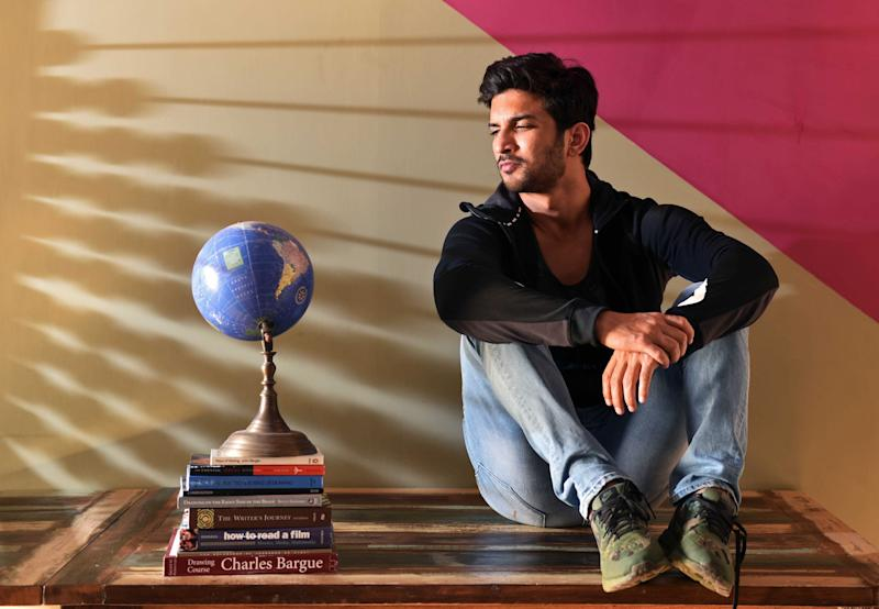 "MUMBAI, INDIA - DECEMBER 26: (EDITOR'S NOTE: This is an exclusive image of Hindustan Times) Bollywood actor Sushant Singh Rajput poses during an exclusive interview with HT Cafe-Hindustan Times, at his residence at Bandra, on December 26, 2016 in Mumbai, India. During the interview, he said, ""As an actor, I often work in self-interest. The way people like playing games, watching movies, I love acting. So, all I was concerned about was the experience of working with Neeraj (Pandey) and the process of knowing and becoming Dhoni. The commerce is for the producers to handle and fame for my PR agency (smiles)."" (Photo by Pratham Gokhale/Hindustan Times via Getty Images)"