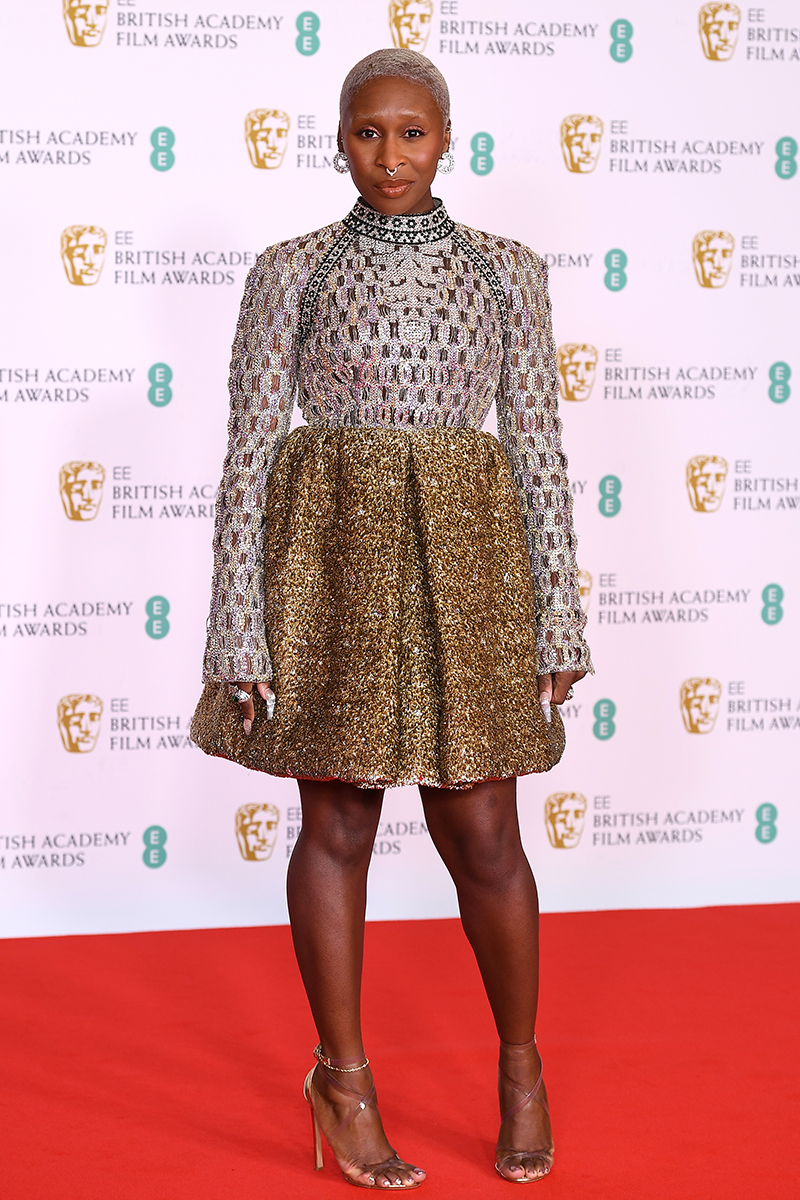 <p>Cynthia Erivo stuns in a gold and silver Louis Vuitton mini dress with intricate details around the bodice and collar, finished with barely-there heels.</p>