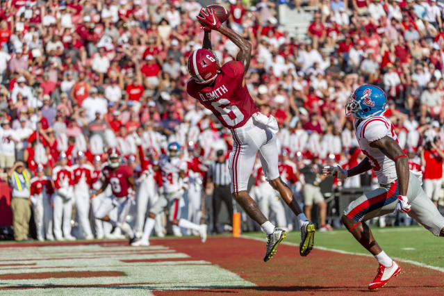 Alabama wide receiver DeVonta Smith (6) leaps into the air for his fourth touchdown reception well ahead of coverage from Mississippi defensive back Keidron Smith (20) during the first half of an NCAA college football game, Saturday, Sept. 28, 2019, in Tuscaloosa, Ala. (AP Photo/Vasha Hunt)