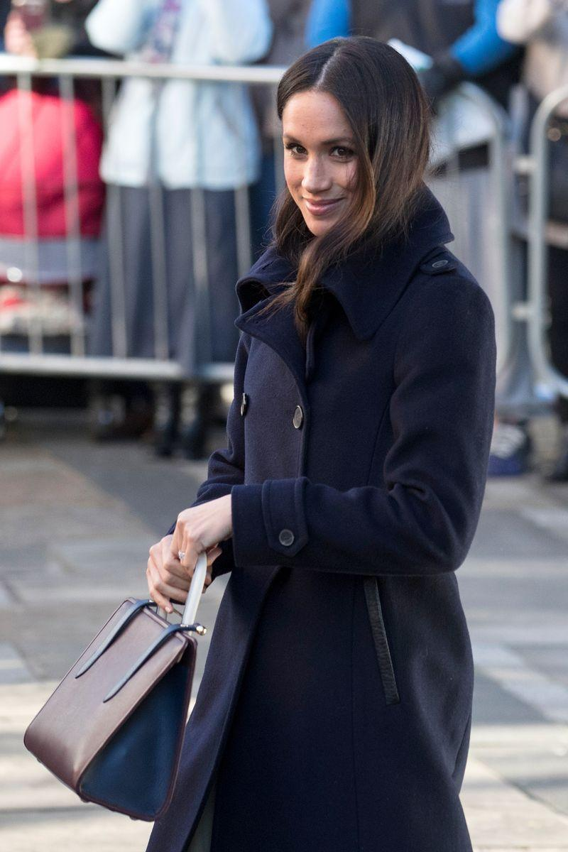 <p>And here she is with a tote during an appearance in December 2017, which is also not the traditional clutch! </p>