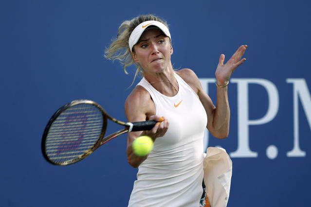 Elina Svitolina, of Ukraine, hits a forehand to Anastasija Sevastova, of Latvia, during the fourth round of the U.S. Open tennis tournament Sunday, Sept. 2, 2018, in New York. (AP Photo/Jason DeCrow)