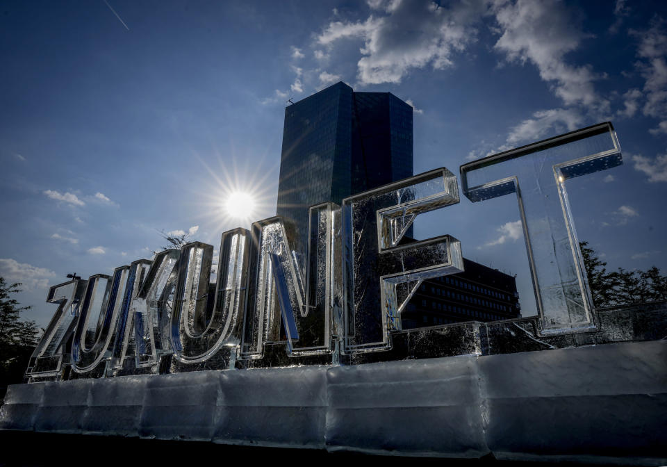 """Letters of melting ice reading """"Zukunft"""" (future) was set up by Greenpeace activist in front of the European Central Bank in Frankfurt, Germany, Thursday, Sept. 9, 2021. The ECB will have its governing council meeting on Thursday. (AP Photo/Michael Probst)"""