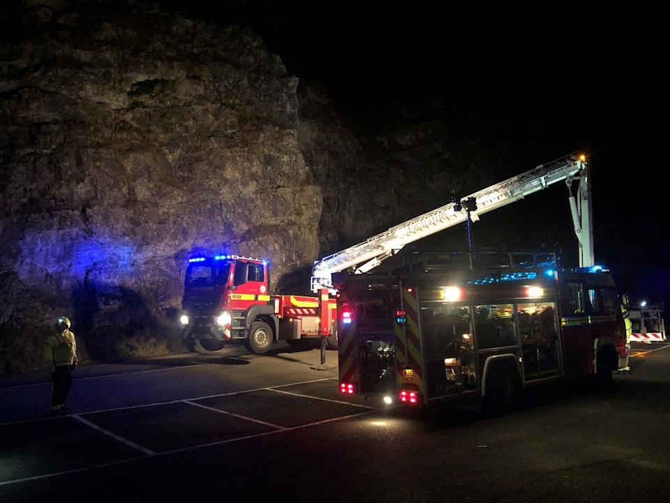 Emergency services on the scene at m Cheddar Gorge in Somerset on Sunday after two people became stuck on top of the cliffs. (SWNS)