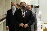 Secretary of State Mike Pompeo walks into a meeting with the Taliban's peace negotiation team amid talks between the Taliban and the Afghan government, Saturday, Nov. 21, 2020, in Doha, Qatar. (AP Photo/Patrick Semansky, Pool)
