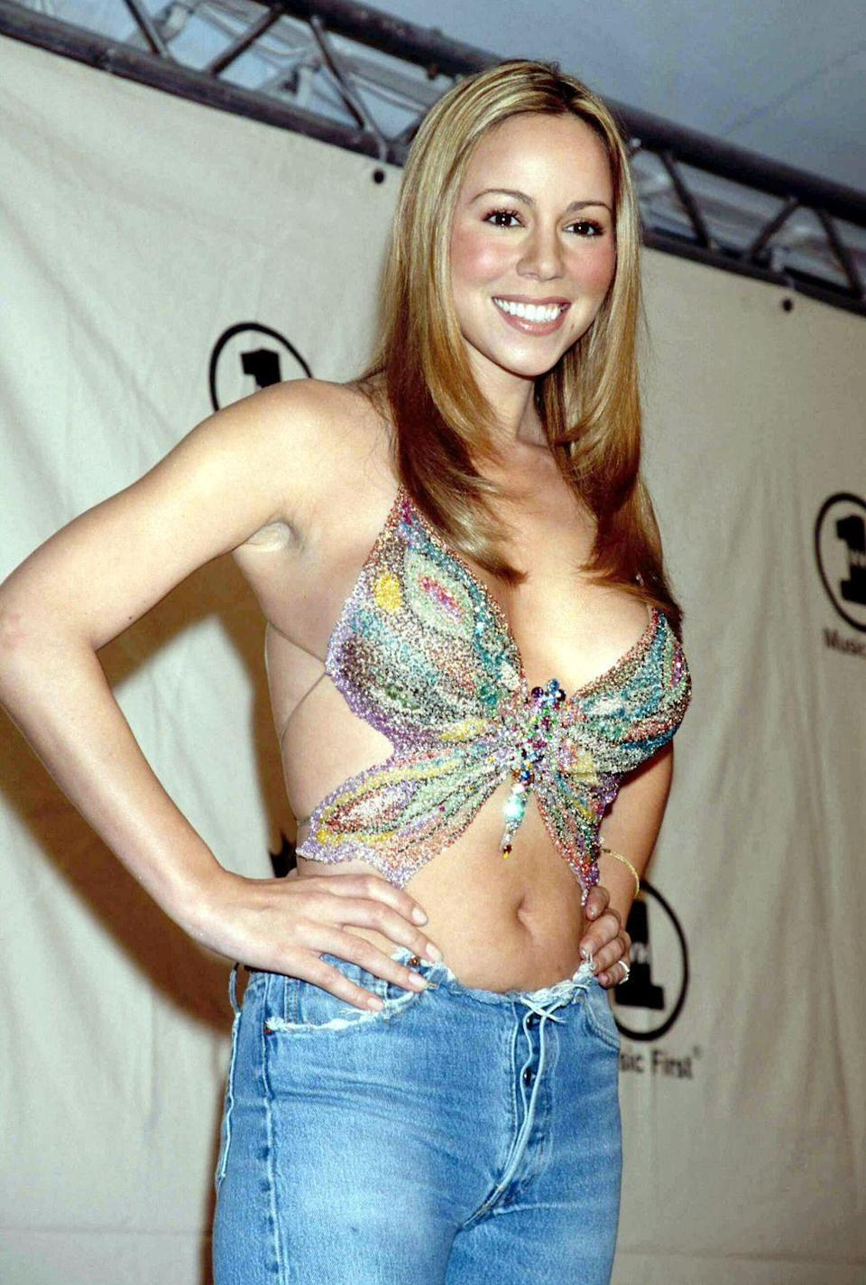 <p>Between the late '90s and early 2000s, butterflies were all over the fashion industry and beyond. Mariah Carrey's 1997 album certainly helped with that. From tops to hair clips to trousers, the silhouette and patterns associated with the winged insect were fluttering all over. </p>