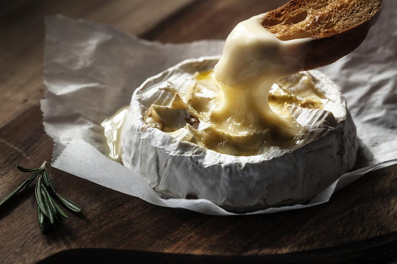 <p>No matter how much those January blues are getting you down, a load of gooey melted cheese should surely fix things? Baked camembert is an easy one to do, and guaranteed to put a smile on your face [Photo: Getty] </p>