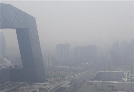 The CCTV building is seen amid the heavy haze in Beijing's central business district