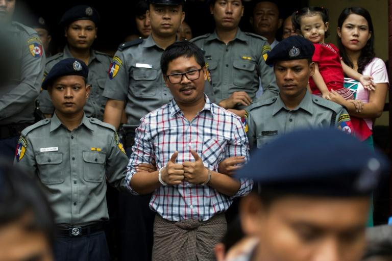 If convicted, the two Reuters journalists could each face up to 14 years in prison for violating Myanmar's state secrets law