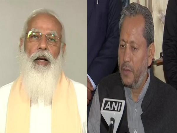 Prime Minister Narendra Modi (left) Uttarakhand Chief Minister Tirath Singh Rawat (right). (File photo)
