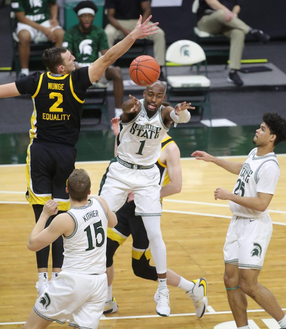Michigan State Spartans guard Joshua Langford (1) passes against Iowa Hawkeyes forward Jack Nunge (2) during second half action at Breslin Center on Saturday, February 13, 2021.