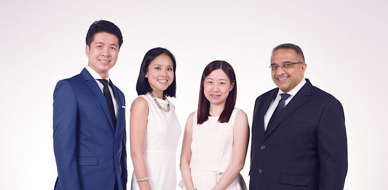 The OCBC Financial Masterclass is conducted by (from left) Wayne Chua, Head of Bancassurance; Jessica Goh, Product Manager, Wealth Management; Tan Siew Lee, Head of Wealth Management Singapore, and Vasu Menon, Senior Investment Strategist. (PHOTO: OCBC Bank)
