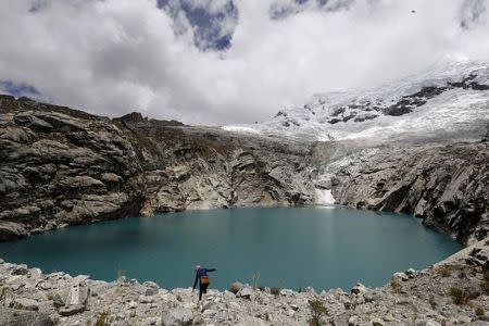 A general view of lake Laguna 513, at more than 13,000 feet above sea level in front of the Hualcan glacier in Huascaran natural reserve in Ancash November 29, 2014. REUTERS/Mariana Bazo