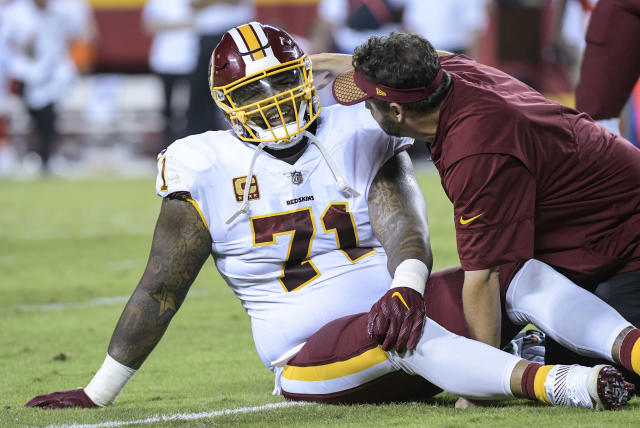 This Oct. 2, 2017 photo shows Washington Redskins offensive tackle Trent Williams (71) being treated during the first half of an NFL football game in Kansas City, Mo. Williams has played through so many injuries that he figures something has to be torn or broken to not be in uniform. After missing just three games for injury from 2012-2016, Williams has missed three of the past five with so severe a problem in his right knee that itll require surgery at some point. (AP Photo/Reed Hoffmann)