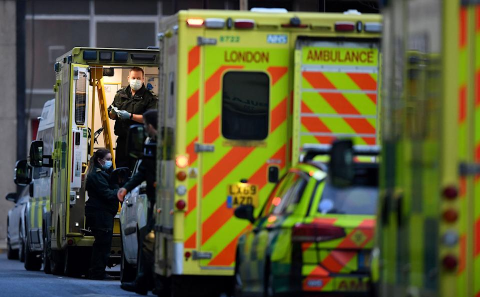 A paramedic works in the back of an ambulance, parked outside the Royal London hospital in London on January 12, 2021 as surging cases of the novel coronavirus are placing health services under increasing pressure. - People who flout coronavirus lockdown rules are putting lives at risk, the British government said on Tuesday, as cases surge to record highs and rumours swirl of potentially tougher restrictions. Britain is currently in its third lockdown, with schools and non-essential shops closed, as a new strain of the virus spreads rapidly across the country. (Photo by DANIEL LEAL-OLIVAS / AFP) (Photo by DANIEL LEAL-OLIVAS/AFP via Getty Images)