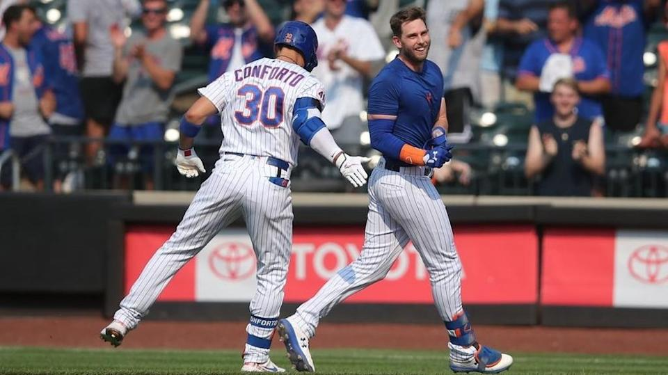 New York Mets second baseman Jeff McNeil (right) celebrates his walk-off single against the Milwaukee Brewers with right fielder Michael Conforto (30) at Citi Field.