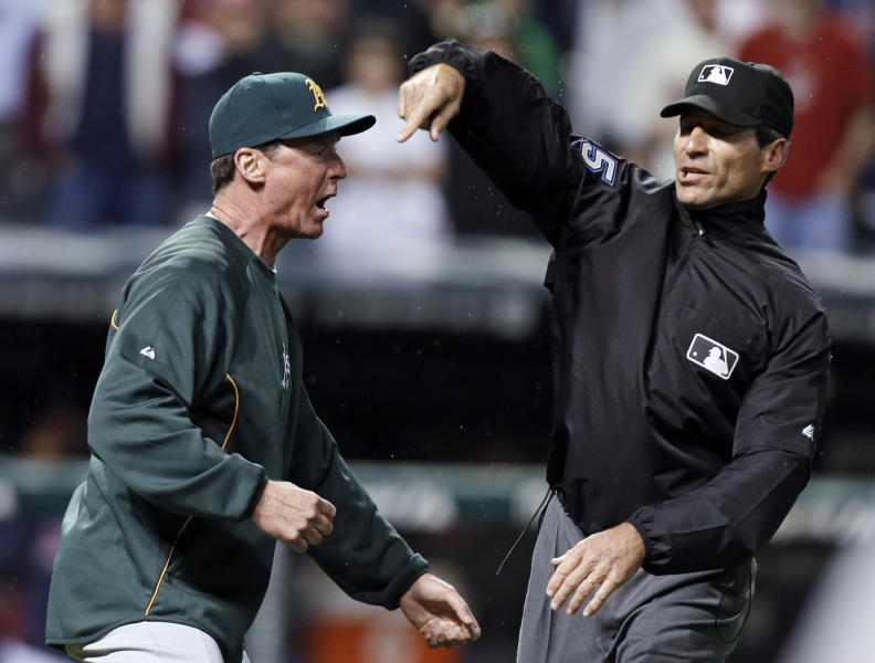 Umpire Angel Hernandez, right, ejects Oakland Athletics manager Bob Melvin for arguing a call in the ninth inning of a baseball game against the Cleveland Indians on Wednesday, May 8, 2013, in Cleveland. Melvin argued a double by Adam Rosales was a home run but the umpires upheld the call after a video review. The Indians won 4-3. (AP Photo/Mark Duncan)