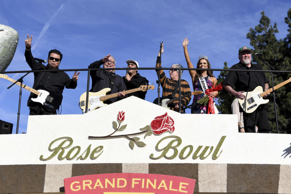 FILE - In this Wednesday, Jan. 1, 2020, file photo, the band Los Lobos performs on the Wells Fargo float at the 131st Rose Parade in Pasadena, Calif. Organizers have canceled the 2021 Rose Parade because of the impact of the coronavirus pandemic on long-range planning for the New Year's tradition. The Pasadena, California, Tournament of Roses Association said Wednesday, July 15, 2020, that the decision was put off until organizers were certain that safety restrictions would prevent the staging of the 132nd parade. (AP Photo/Michael Owen Baker, File)