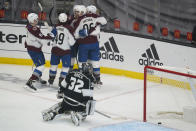 Colorado Avalanche players celebrate after a goal by right wing Mikko Rantanen (96) against the Los Angeles Kings during the first period of an NHL hockey game Thursday, Jan. 21, 2021, in Los Angeles. (AP Photo/Ashley Landis)
