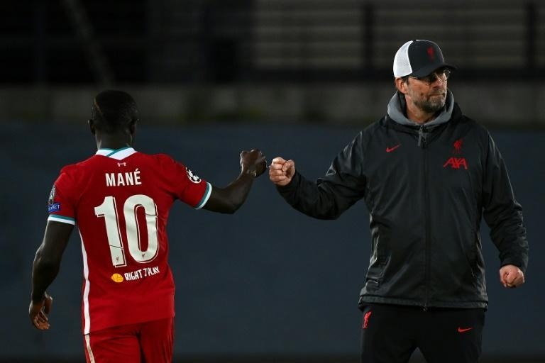 Jurgen Klopp (right)has to inspire a Liverpool fightback against Real Madird in front of an empty Anfield