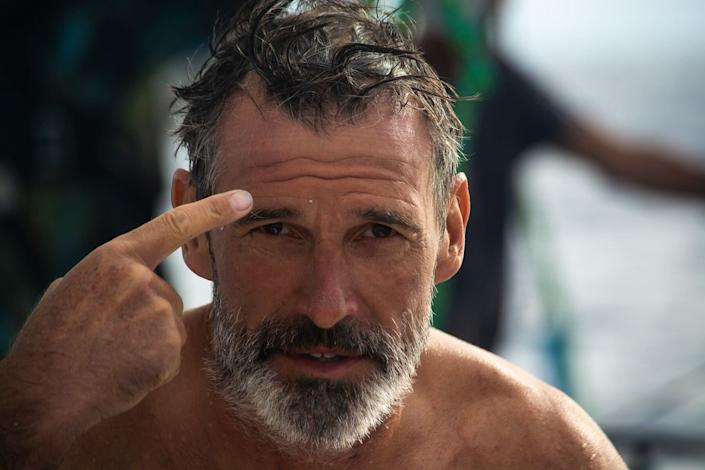 Lecomte emerges from the water with a piece of plastic stuck to his forehead. (Photo: @dwlangdon/The Vortex Swim)