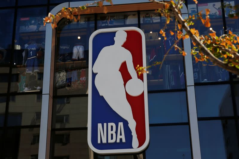 NBA logo is seen on the facade of its flagship store at the Wangfujing shopping street in Beijing