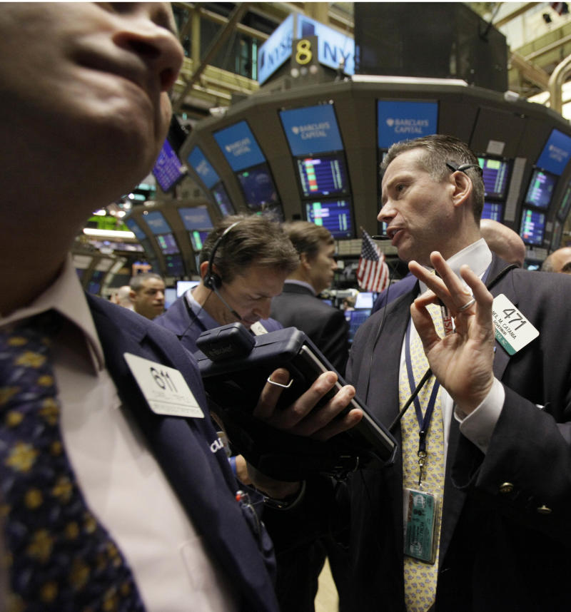 Trader Neil Catania, right, works on the floor of the New York Stock Exchange Wednesday, March 2, 2011. (AP Photo/Richard Drew)