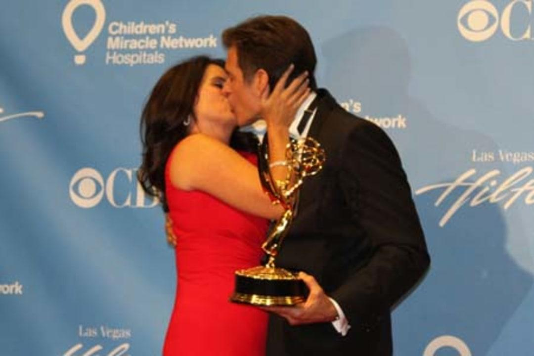 Dr. Mehmet Oz gets a smooch from his wife after winning at the 2011 Daytime Emmy Awards