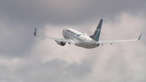WestJet landed in Charlottetown at midday Friday after a long absence due to the COVID-19 pandemic.  (CBC - image credit)