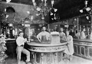 <p>It's believed that bars in Paris have been around since the early 1600s. This portrait of men at a bar in Paris showcase the ornate style and architecture in France.<br></p>