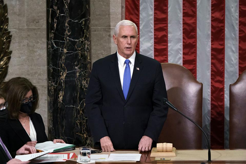 Vice President Mike Pence certifies the Electoral College votes cast in November's presidential election during a joint session of Congress, after working through the night, at the Capitol on January 7. Source: Getty Images