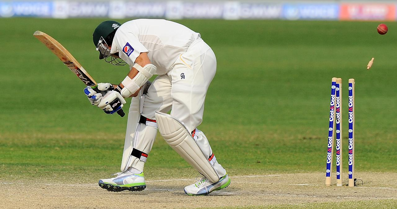Pakistan batsman Saeed Ajmal is bowled out during the final day of the second cricket Test match between Pakistan and Sri Lanka at the Dubai International Cricket Stadium in Dubai on January 12, 2014. AFP PHOTO/Ishara S. KODIKARA
