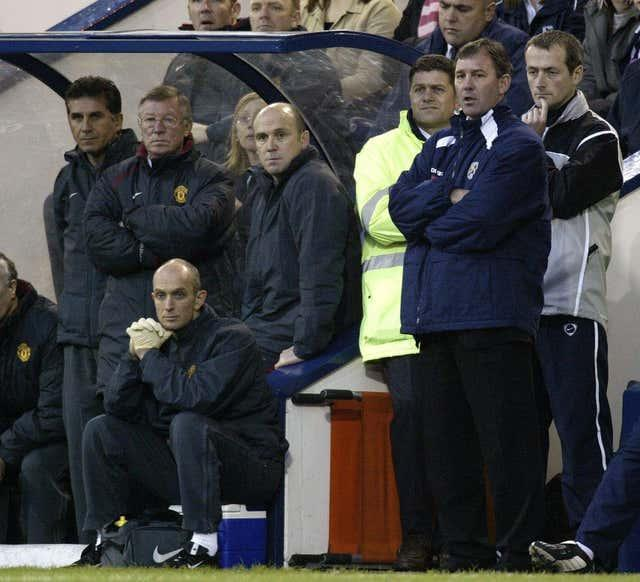 Bryan Robson (second right) on the touchline as West Brom manager