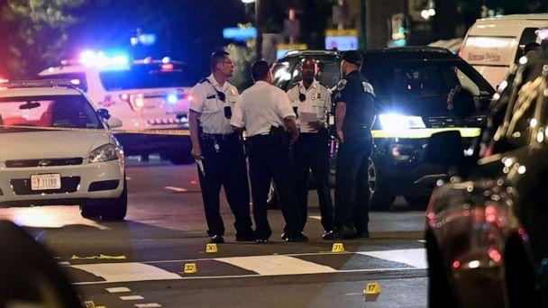 PHOTO: Police officers work at the scene of a shooting outside a restaurant in Washington, D.C., on July 22, 2021. (Brendan Smialowski/AFP via Getty Images, FILE)