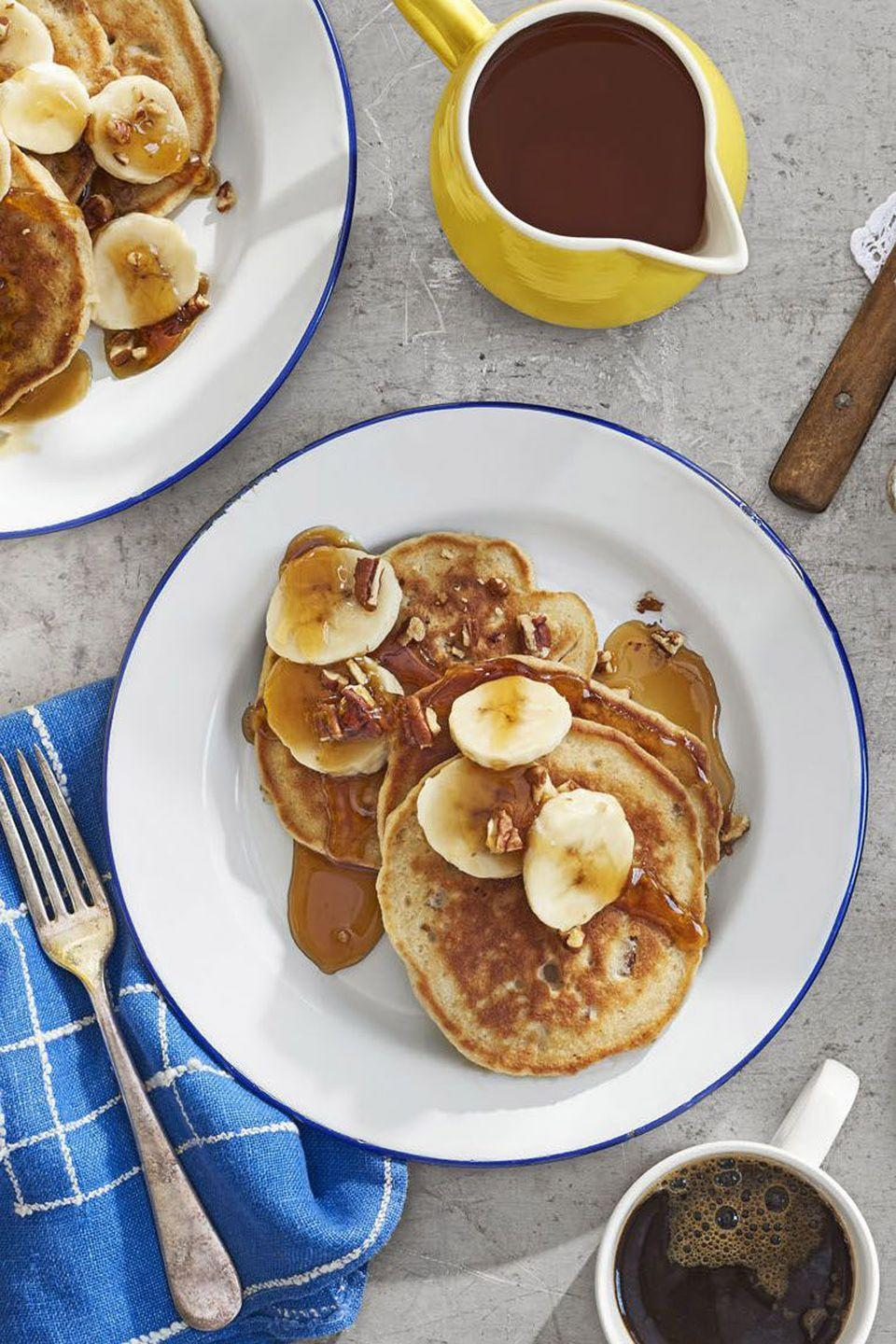 """<p>Toasted pecans give these banana-filled pancakes a sweet and satisfying crunch.</p><p><strong><a href=""""https://www.countryliving.com/food-drinks/recipes/a41653/banana-bread-flapjacks-recipe/"""" rel=""""nofollow noopener"""" target=""""_blank"""" data-ylk=""""slk:Get the recipe"""" class=""""link rapid-noclick-resp"""">Get the recipe</a>.</strong> </p>"""