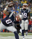 New England Patriots tight end Rob Gronkowski (87) spikes the ball after catching a five-yard touchdown pass during the second half of the NFL football AFC Championship game against the Indianapolis Colts Sunday, Jan. 18, 2015, in Foxborough, Mass. (AP Photo/Elise Amendola)